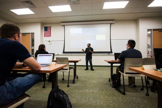 UCI Boot Camp instructor speaking to a classroom of students